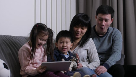 Happy family watching a video together