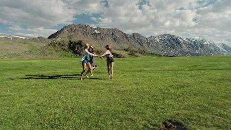 Happy friends having fun on the meadow