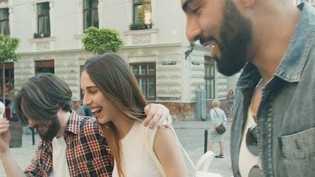 Happy friends walking down the street