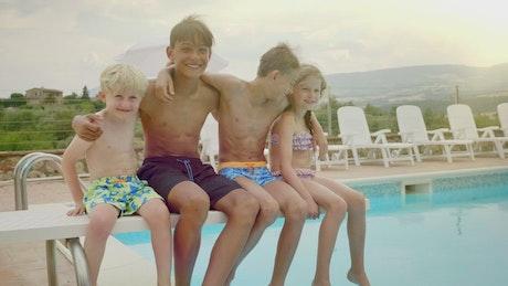 Happy kids outside the pool