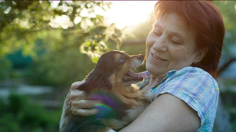 Happy lady caresses her little dog