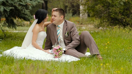 Happy newlywed couple in the park