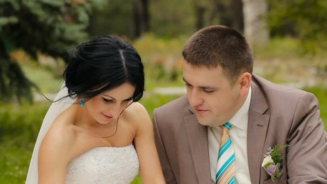 Happy newlyweds in the garden