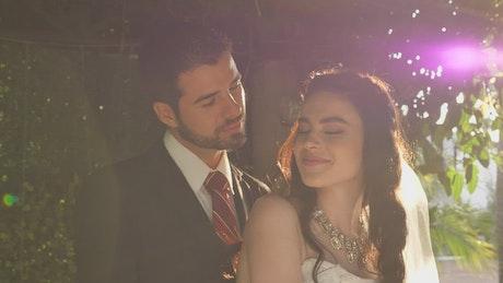 Happy newlyweds posing