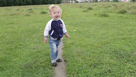 Happy toddler chasing the camera