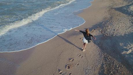 Happy woman enjoying the beach