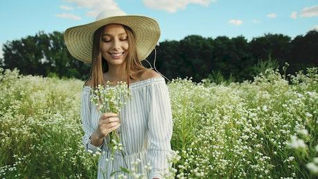 Happy woman in a flower field