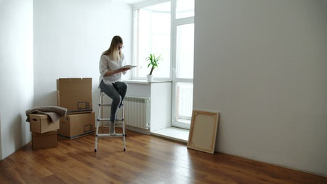 Happy woman moving to her new apartment