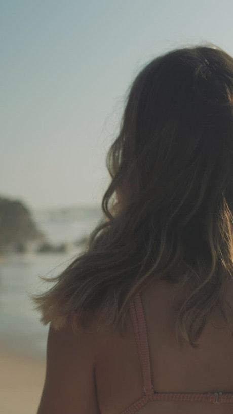 Happy woman walking on the beach