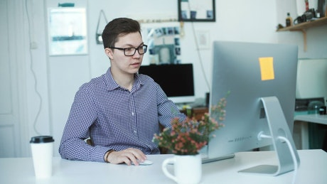Happy young businessman working from home