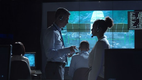 Having a conversation in space control center