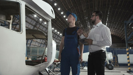 Having a conversation in the hangar