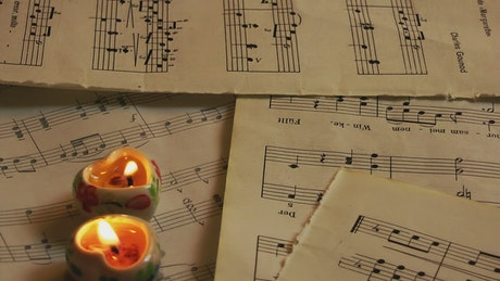 Heart candles on sheet music