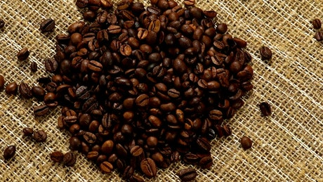 Heart of coffee beans on a natural fabric
