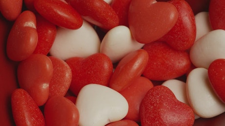 Heart shaped candy falling