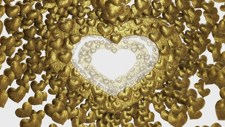 Heart shaped frames made with golden hearts