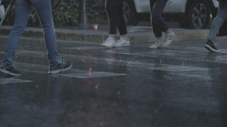 Heavy rain as people walk across town
