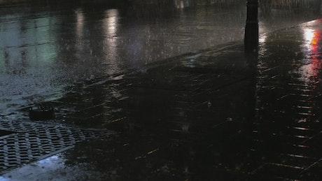 Heavy rain falling on the pavement