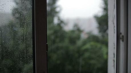 Heavy rain from an open window