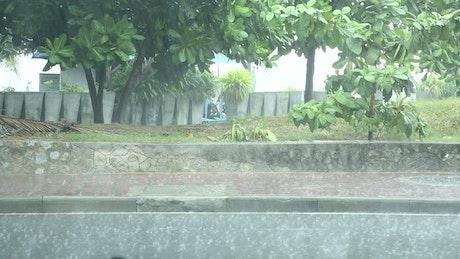 Heavy rain in the street sidewalk