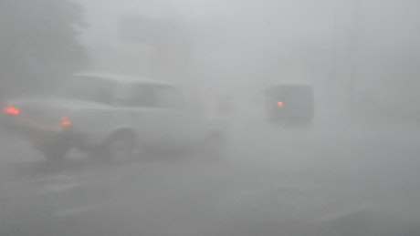 Heavy rain in traffic