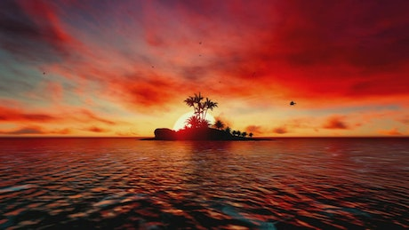 Helicopter flying over an island at sunset