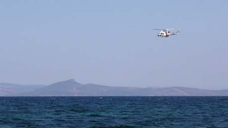 Helicopter of salvation searching the sea