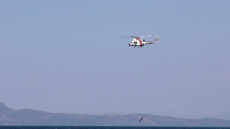 Helicopter rescuing diver from the sea