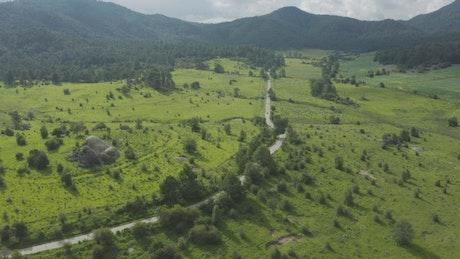 Highway crossing between huge fields in nature