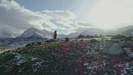 Hiker walking on a hilly landscape