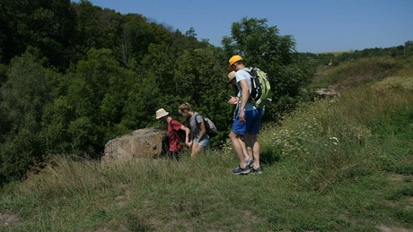 Hikers moving down a steep path