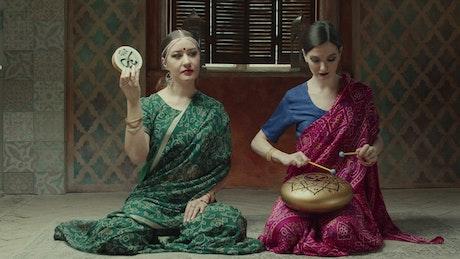Hindu stylish women playing music