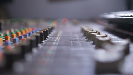 Hiphop producer using a mixing console