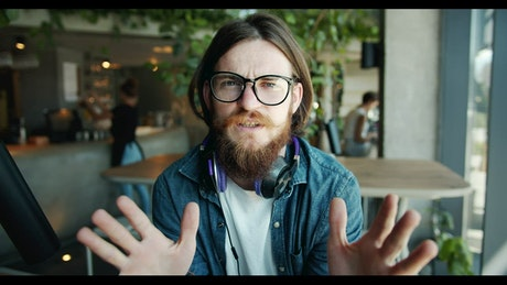 Hipster blogger talking to the camera