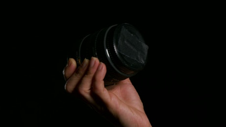 Holding a camera lens cap