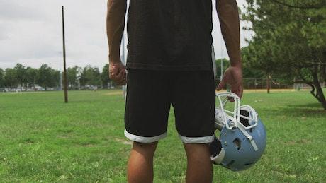 Holding a Football helmet