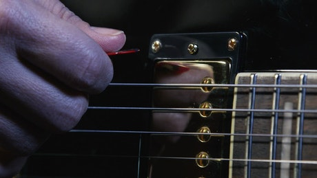 Holding a guitar pick