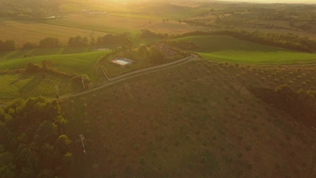 Holiday house in the middle of the field, aerial view