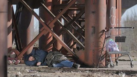 Homeless man covering himself