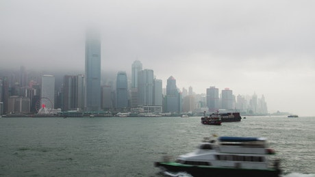 Hong Kong harbor traffic on a cloudy day