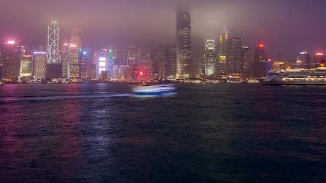Hong Kong harbor with city flashing buildings