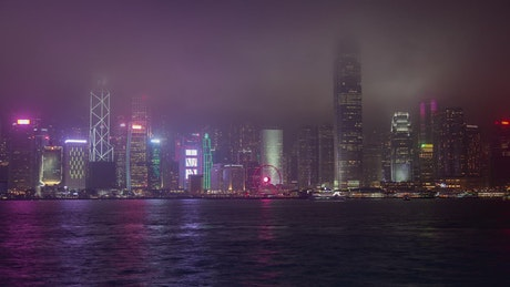 Hong Kong skyscrapers on a foggy night