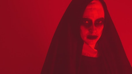 Horrifying woman disguised as a ghost nun
