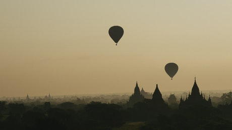 Hot air balloons flying during sunrise