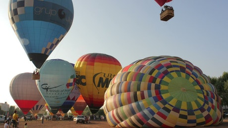 Hot air balloons taking off from the ground