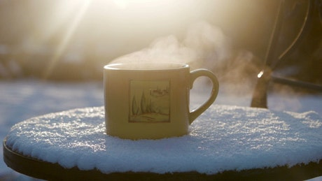 Hot beverage and steam outdoors