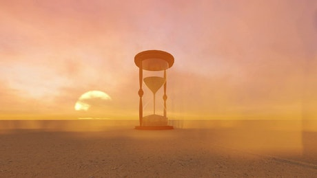 Hourglass in the middle of a sand desert