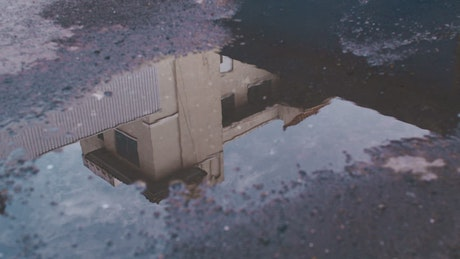 House reflected in a puddle