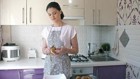 Housewife peeling a potato with a knife