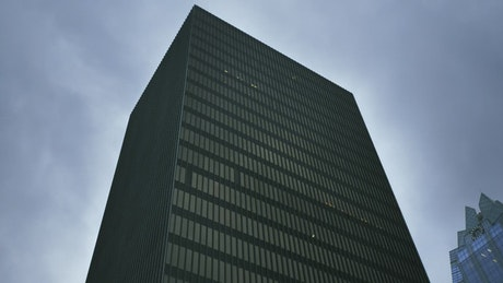 Huge building covered by windows shot from below